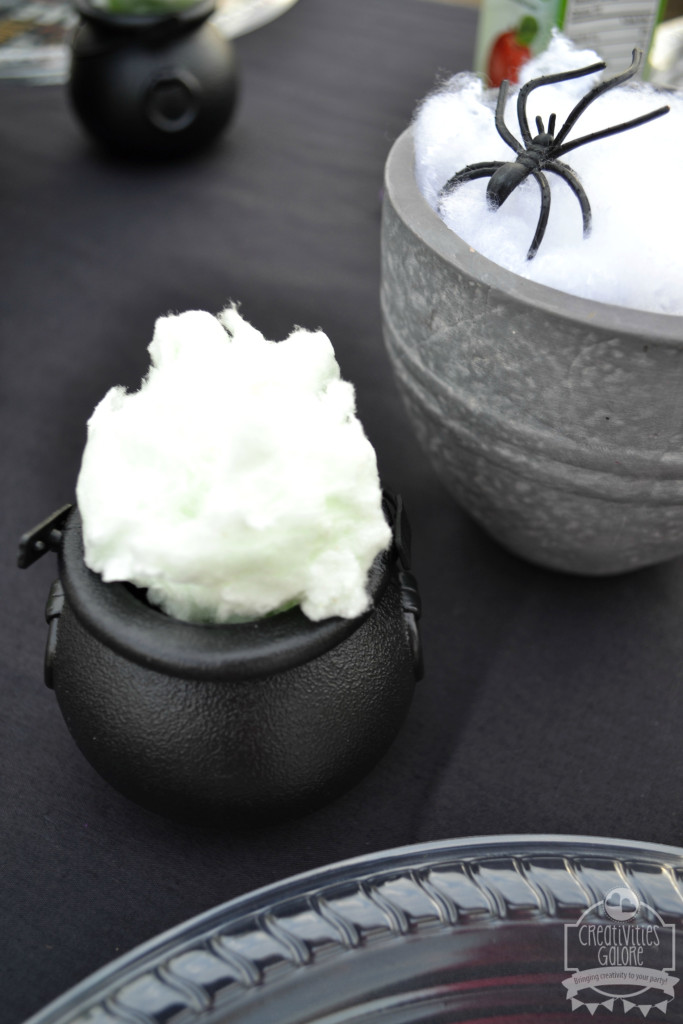 Halloween Table mini cauldrons filled with cotton candy