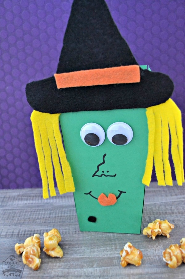 This witch popcorn box is so easy to create. All you need is a couple of craft supplies and some imagination and you have yourself a witch popcorn box