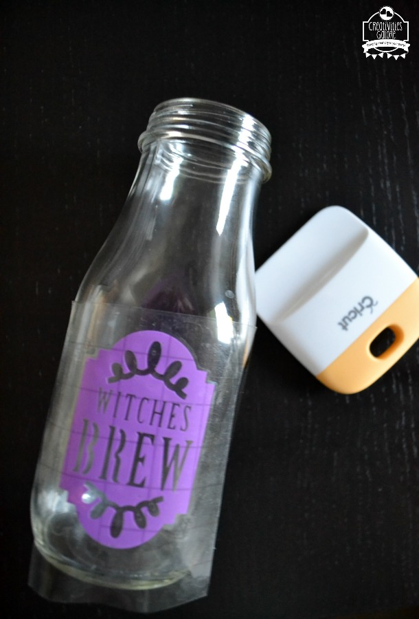 I created this witches brew drinking glass super quick with my Cricut Explore Air 2. It makes a great addition to your Halloween party tablescape